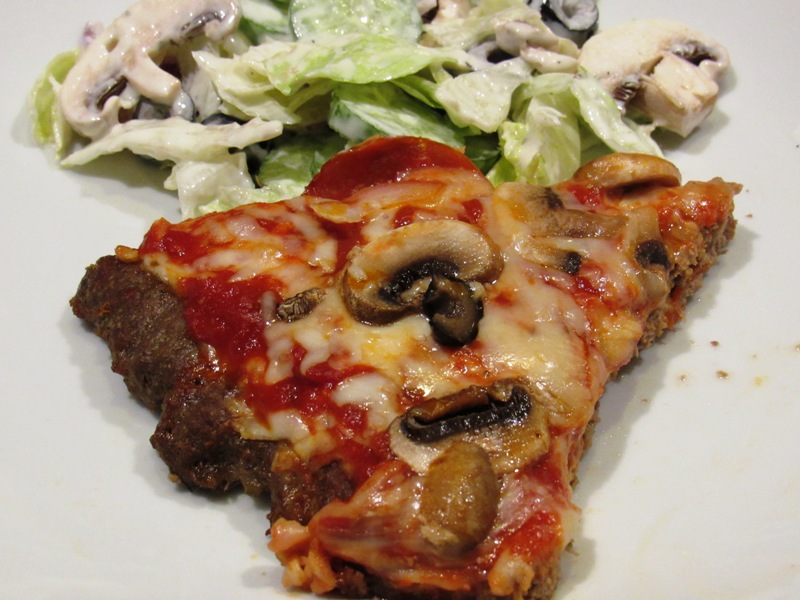 Meatza Slice with a side of salad